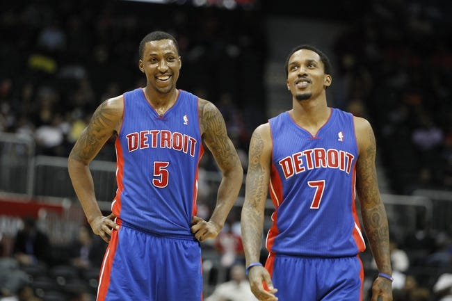 Apr 8, 2014; Atlanta, GA, USA; Detroit Pistons guard Kentavious Caldwell-Pope (5) and guard Brandon Jennings (7) talk against the Atlanta Hawks in the second quarter at Philips Arena. Mandatory Credit: Brett Davis-USA TODAY Sports