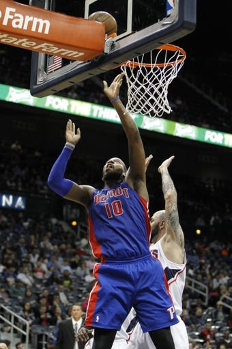 Apr 8, 2014; Atlanta, GA, USA; Detroit Pistons forward Greg Monroe (10) shoots the ball against the Atlanta Hawks in the second quarter at Philips Arena. Mandatory Credit: Brett Davis-USA TODAY Sports