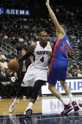 Apr 8, 2014; Atlanta, GA, USA; Atlanta Hawks forward Paul Millsap (4) drives to the basket against the Detroit Pistons in the third quarter at Philips Arena. Mandatory Credit: Brett Davis-USA TODAY Sports