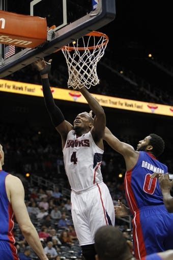 Apr 8, 2014; Atlanta, GA, USA; Atlanta Hawks forward Paul Millsap (4) shoots the ball against the Detroit Pistons in the third quarter at Philips Arena. Mandatory Credit: Brett Davis-USA TODAY Sports