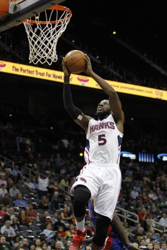 Apr 8, 2014; Atlanta, GA, USA; Atlanta Hawks forward DeMarre Carroll (5) dunks the ball against the Detroit Pistons in the third quarter at Philips Arena. Mandatory Credit: Brett Davis-USA TODAY Sports