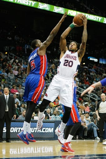 Apr 8, 2014; Atlanta, GA, USA; Atlanta Hawks forward Cartier Martin (20) shoots the ball against the Detroit Pistons in the fourth quarter at Philips Arena. The Pistons defeated the Hawks 102-95. Mandatory Credit: Brett Davis-USA TODAY Sports