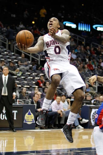 Apr 8, 2014; Atlanta, GA, USA; Atlanta Hawks guard Jeff Teague (0) shoots a lay up against the Detroit Pistons in the fourth quarter at Philips Arena. The Pistons defeated the Hawks 102-95. Mandatory Credit: Brett Davis-USA TODAY Sports