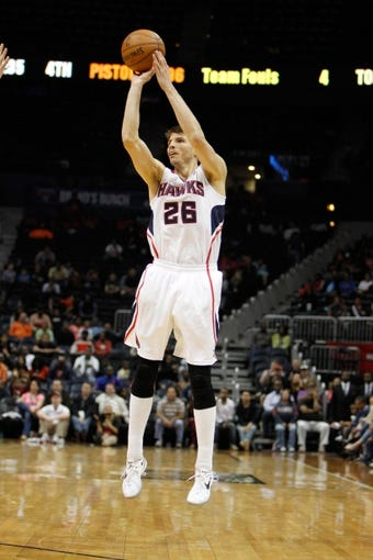 Apr 8, 2014; Atlanta, GA, USA; Atlanta Hawks guard Kyle Korver (26) shoots the ball against the Detroit Pistons in the fourth quarter at Philips Arena. The Pistons defeated the Hawks 102-95. Mandatory Credit: Brett Davis-USA TODAY Sports
