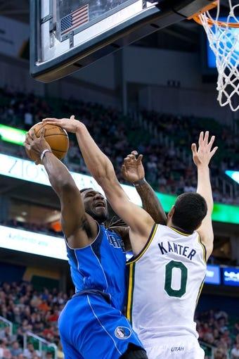 Apr 8, 2014; Salt Lake City, UT, USA; Utah Jazz center Enes Kanter (0) blocks the shot of Dallas Mavericks forward Jae Crowder (9) during the first half at EnergySolutions Arena. Mandatory Credit: Russ Isabella-USA TODAY Sports