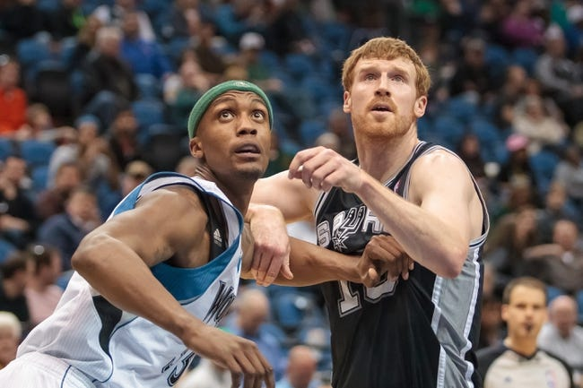 Apr 8, 2014; Minneapolis, MN, USA; Minnesota Timberwolves forward Dante Cunningham (33) boxes out San Antonio Spurs forward Matt Bonner (15) in the fourth quarter at Target Center. The Minnesota Timberwolves win 110-91. Mandatory Credit: Brad Rempel-USA TODAY Sports
