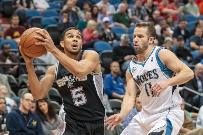 Apr 8, 2014; Minneapolis, MN, USA; San Antonio Spurs guard Cory Joseph (5) shoots in the fourth quarter against the Minnesota Timberwolves guard J.J. Barea (11) at Target Center. The Minnesota Timberwolves win 110-91. Mandatory Credit: Brad Rempel-USA TODAY Sports