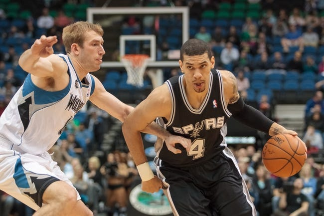 Apr 8, 2014; Minneapolis, MN, USA; San Antonio Spurs guard Danny Green (4) dribbles in the fourth quarter against the Minnesota Timberwolves forward Robbie Hummel (6) at Target Center. The Minnesota Timberwolves win 110-91. Mandatory Credit: Brad Rempel-USA TODAY Sports