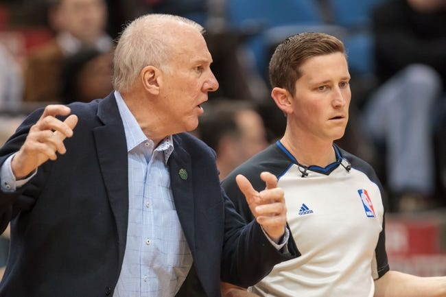 Apr 8, 2014; Minneapolis, MN, USA; San Antonio Spurs head coach Gregg Popovich talks to referee Nick Buchert in the third quarter against the Minnesota Timberwolves at Target Center. The Minnesota Timberwolves win 110-91. Mandatory Credit: Brad Rempel-USA TODAY Sports