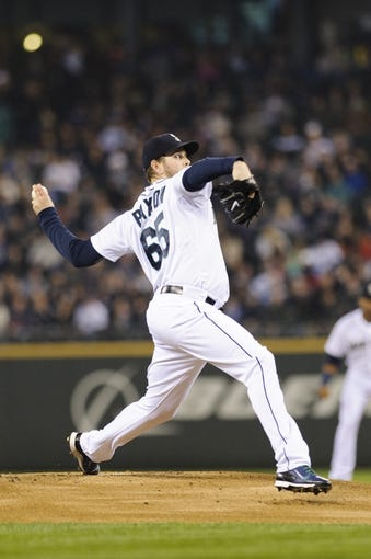 Apr 8, 2014; Seattle, WA, USA; Seattle Mariners starting pitcher James Paxton (65) pitches to the Los Angeles Angels during the first inning at Safeco Field. Mandatory Credit: Steven Bisig-USA TODAY Sports