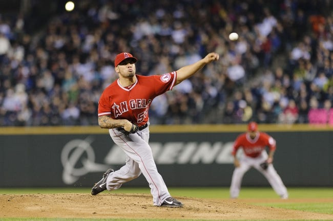 Apr 8, 2014; Seattle, WA, USA; Los Angeles Angels starting pitcher Hector Santiago (53) pitches to the Seattle Mariners during the second inning at Safeco Field. Mandatory Credit: Steven Bisig-USA TODAY Sports