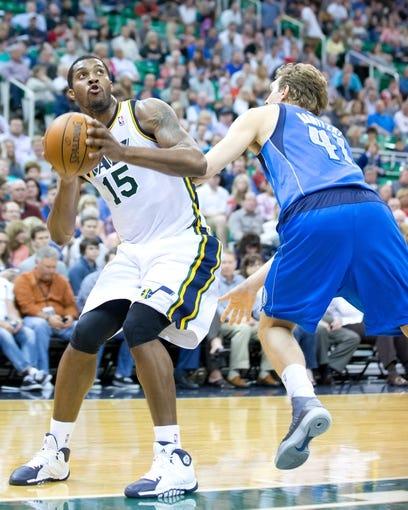 Apr 8, 2014; Salt Lake City, UT, USA; Dallas Mavericks forward Dirk Nowitzki (41) defends against Utah Jazz center Derrick Favors (15) during the second half at EnergySolutions Arena. The Mavericks won 95-83. Mandatory Credit: Russ Isabella-USA TODAY Sports