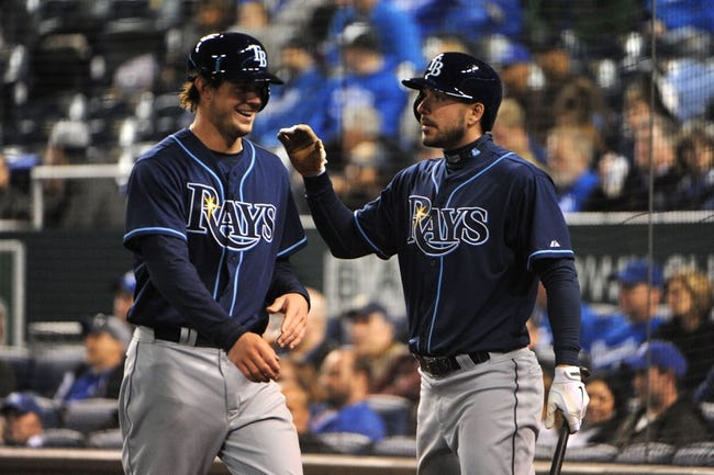 Apr 8, 2014; Kansas City, MO, USA; Tampa Bay Rays right fielder Wil Myers (9) is congratulated by right fielder Matt Joyce (20) after scoring against the Kansas City Royals in the ninth inning at Kauffman Stadium. Mandatory Credit: John Rieger-USA TODAY Sports