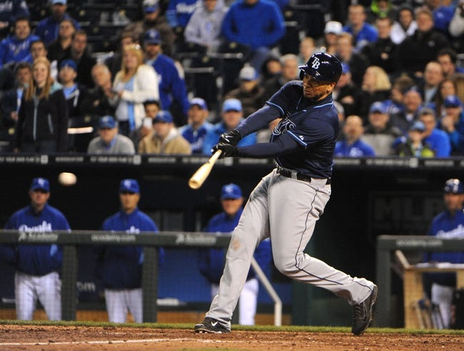 Apr 8, 2014; Kansas City, MO, USA; Tampa Bay Rays first baseman James Loney (21) drives in a run with a hit  against the Kansas City Royals in the ninth inning at Kauffman Stadium. Tampa Bay won the game 1-0. Mandatory Credit: John Rieger-USA TODAY Sports