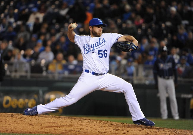 Apr 8, 2014; Kansas City, MO, USA; Kansas City Royals relief pitcher Greg Holland (56) delivers a pitch against the Tampa Bay Rays in the ninth inning at Kauffman Stadium. Tampa Bay won the game 1-0. Mandatory Credit: John Rieger-USA TODAY Sports
