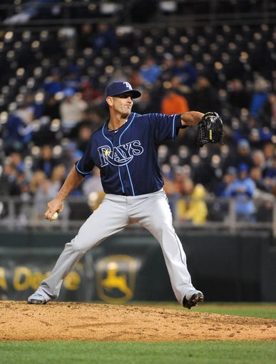 Apr 8, 2014; Kansas City, MO, USA; Tampa Bay Rays relief pitcher Grant Balfour (50) delivers a pitch in the ninth inning against the Kansas City Royals at Kauffman Stadium. Tampa Bay won the game 1-0. Mandatory Credit: John Rieger-USA TODAY Sports