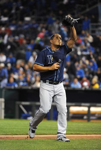 Apr 8, 2014; Kansas City, MO, USA; Tampa Bay Rays relief pitcher Joel Peralta (62) celebrates a strike out after the eighth inning against the Kansas City Royals at Kauffman Stadium. Tampa Bay won the game 1-0. Mandatory Credit: John Rieger-USA TODAY Sports