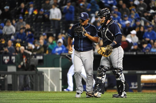 Apr 8, 2014; Kansas City, MO, USA; Tampa Bay Rays relief pitcher Joel Peralta (62) talks to catcher Ryan Hanigan (24) in the eighth inning against the Kansas City Royals at Kauffman Stadium. Tampa Bay won the game 1-0. Mandatory Credit: John Rieger-USA TODAY Sports