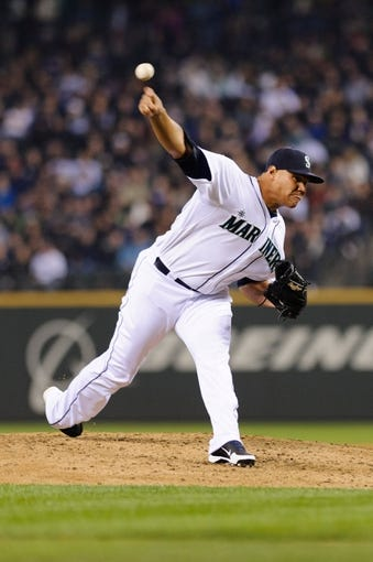 Apr 8, 2014; Seattle, WA, USA; Seattle Mariners relief pitcher Yoervis Medina (31) pitches to the Los Angeles Angels during the sixth inning at Safeco Field. Mandatory Credit: Steven Bisig-USA TODAY Sports
