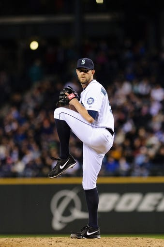 Apr 8, 2014; Seattle, WA, USA; Seattle Mariners relief pitcher Tom Wilhelmsen (54) pitches to the Los Angeles Angels during the eighth inning at Safeco Field.  Seattle defeated Los Angeles 5-3. Mandatory Credit: Steven Bisig-USA TODAY Sports