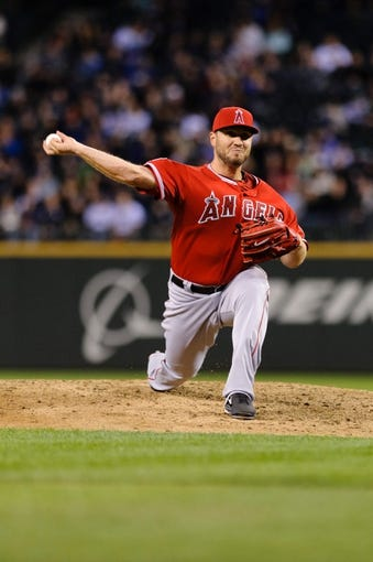 Apr 8, 2014; Seattle, WA, USA; Los Angeles Angels relief pitcher Kevin Jepsen (40) pitches to the Seattle Mariners during the eighth inning at Safeco Field. Seattle defeated Los Angeles 5-3. Mandatory Credit: Steven Bisig-USA TODAY Sports