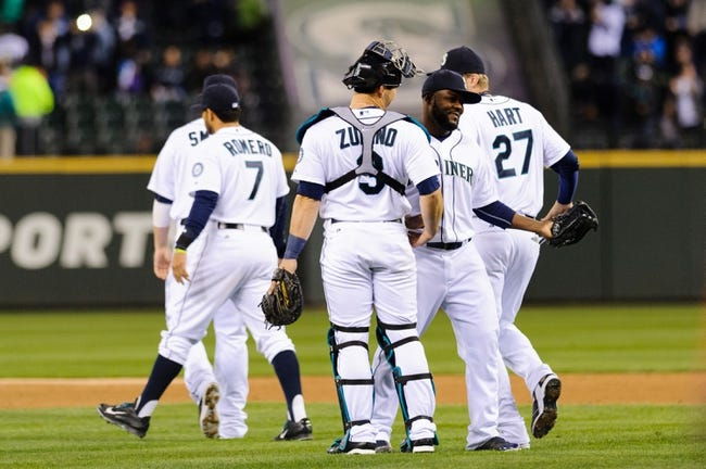 Apr 8, 2014; Seattle, WA, USA; The Seattle Mariners celebrate after defeating the Los Angeles Angels at Safeco Field.  Seattle defeated Los Angeles 5-3. Mandatory Credit: Steven Bisig-USA TODAY Sports