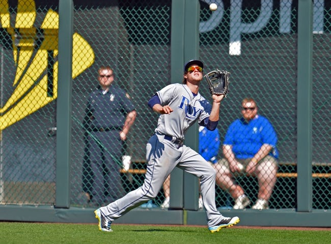 Apr 9, 2014; Kansas City, MO, USA; Tampa Rays right fielder Wil Myers (9) makes a running catch against the Kansas City Royals during the eighth inning at Kauffman Stadium. Kansas City won 7-3. Mandatory Credit: Peter G. Aiken-USA TODAY Sports