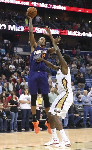Apr 9, 2014; New Orleans, LA, USA; Phoenix Suns forward Channing Frye (8) is defended by New Orleans Pelicans forward Al-Farouq Aminu (0) in the first quarter at Smoothie King Center. Mandatory Credit: Crystal LoGiudice-USA TODAY Sports