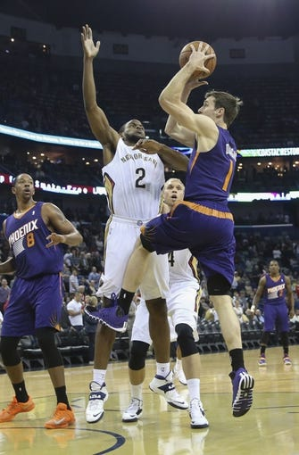 Apr 9, 2014; New Orleans, LA, USA; Phoenix Suns guard Goran Dragic (1) is defended by New Orleans Pelicans forward Darius Miller (2) as he goes up for a basket in the first quarter at Smoothie King Center. Mandatory Credit: Crystal LoGiudice-USA TODAY Sports