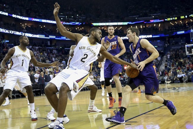 Apr 9, 2014; New Orleans, LA, USA; Phoenix Suns guard Goran Dragic (1) is defended by New Orleans Pelicans forward Darius Miller (2) as he drives toward the basket in the first quarter at Smoothie King Center. Mandatory Credit: Crystal LoGiudice-USA TODAY Sports