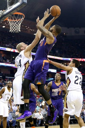 Apr 9, 2014; New Orleans, LA, USA; Phoenix Suns forward Markieff Morris (11) is defended under the basket by New Orleans Pelicans center Greg Stiemsma (34) in the first half at the Smoothie King Center. Mandatory Credit: Crystal LoGiudice-USA TODAY Sports