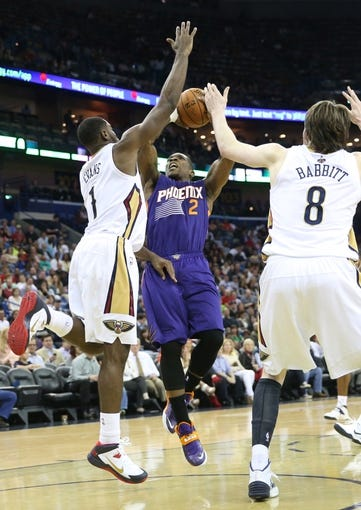 Apr 9, 2014; New Orleans, LA, USA; Phoenix Suns guard Eric Bledsoe (2) is defended by New Orleans Pelicans forward Tyreke Evans (1) and forward Luke Babbitt (8) as he goes up for a basket in the first half at the Smoothie King Center. Mandatory Credit: Crystal LoGiudice-USA TODAY Sports