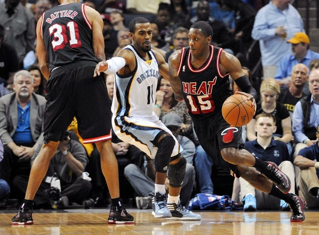 Apr 9, 2014; Memphis, TN, USA; Miami Heat guard Mario Chalmers (15) handles the ball against Memphis Grizzlies guard Mike Conley (11) during the game at FedExForum. Mandatory Credit: Justin Ford-USA TODAY Sports