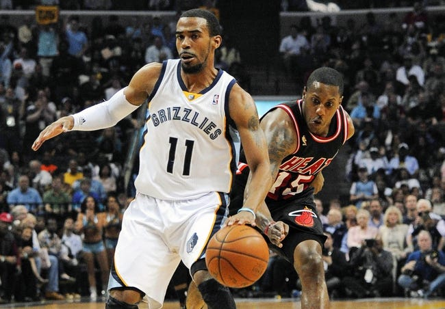 Apr 9, 2014; Memphis, TN, USA; Miami Heat guard Mario Chalmers (15) attempts to steal the ball from Memphis Grizzlies guard Mike Conley (11) during the game at FedExForum. Mandatory Credit: Justin Ford-USA TODAY Sports