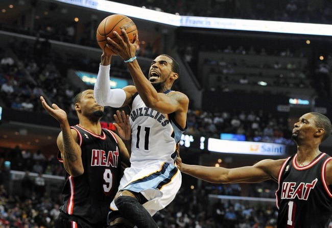Apr 9, 2014; Memphis, TN, USA; Memphis Grizzlies guard Mike Conley (11) lays the ball up during the game at FedExForum. Mandatory Credit: Justin Ford-USA TODAY Sports