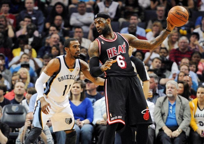 Apr 9, 2014; Memphis, TN, USA; Memphis Grizzlies guard Mike Conley (11) guards Miami Heat forward LeBron James (6) during the game at FedExForum. Mandatory Credit: Justin Ford-USA TODAY Sports
