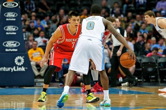 Apr 9, 2014; Denver, CO, USA; Houston Rockets point guard Jeremy Lin (7) guards Denver Nuggets point guard Aaron Brooks (0) in the first quarter at the Pepsi Center. Mandatory Credit: Isaiah J. Downing-USA TODAY Sports
