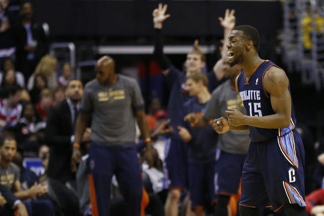 Apr 9, 2014; Washington, DC, USA; Charlotte Bobcats guard Kemba Walker (15) reacts after scoring against the Washington Wizards in overtime at Verizon Center. The Bobcats won 94-88 in overtime. Mandatory Credit: Geoff Burke-USA TODAY Sports