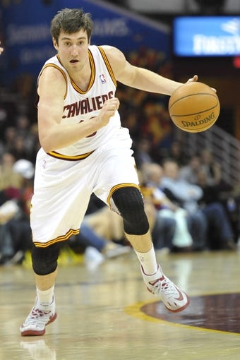 Apr 9, 2014; Cleveland, OH, USA; Cleveland Cavaliers guard Sergey Karasev (10) dribbles the ball against the Detroit Pistons at Quicken Loans Arena. Mandatory Credit: David Richard-USA TODAY Sports