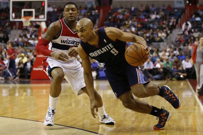Apr 9, 2014; Washington, DC, USA; Charlotte Bobcats guard Gerald Henderson (9) dribbles the ball past Washington Wizards guard Bradley Beal (3) in the third quarter at Verizon Center. The Bobcats won 94-88 in overtime. Mandatory Credit: Geoff Burke-USA TODAY Sports