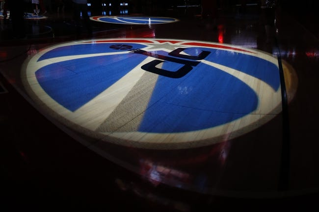 Apr 9, 2014; Washington, DC, USA; Washington Wizards logos are projected on the court during player intros prior to the Wizards' game against the Charlotte Bobcats at Verizon Center. The Bobcats won 94-88 in overtime. Mandatory Credit: Geoff Burke-USA TODAY Sports
