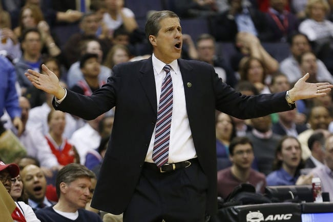 Apr 9, 2014; Washington, DC, USA; Washington Wizards head coach Randy Wittman gestures from the bench against the Charlotte Bobcats in the third quarter at Verizon Center. The Bobcats won 94-88 in overtime. Mandatory Credit: Geoff Burke-USA TODAY Sports