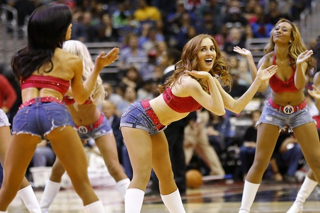 Apr 9, 2014; Washington, DC, USA; The Washington Wizards Girls dance on the court during a timeout against the Charlotte Bobcats in the third quarter at Verizon Center. The Bobcats won 94-88 in overtime. Mandatory Credit: Geoff Burke-USA TODAY Sports
