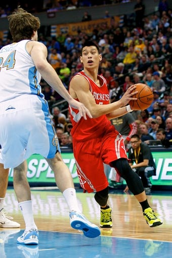 Apr 9, 2014; Denver, CO, USA; Denver Nuggets power forward Jan Vesely (24) guards Houston Rockets point guard Jeremy Lin (7) in the second quarter at the Pepsi Center. Mandatory Credit: Isaiah J. Downing-USA TODAY Sports