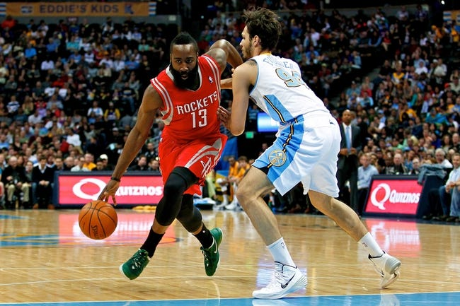 Apr 9, 2014; Denver, CO, USA; Denver Nuggets shooting guard Evan Fournier (94) guards Houston Rockets shooting guard James Harden (13) in the second quarter at the Pepsi Center. Mandatory Credit: Isaiah J. Downing-USA TODAY Sports