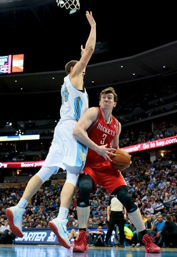 Apr 9, 2014; Denver, CO, USA; Denver Nuggets center Timofey Mozgov (25) guards Houston Rockets center Omer Asik (3) in the second quarter at the Pepsi Center. Mandatory Credit: Isaiah J. Downing-USA TODAY Sports
