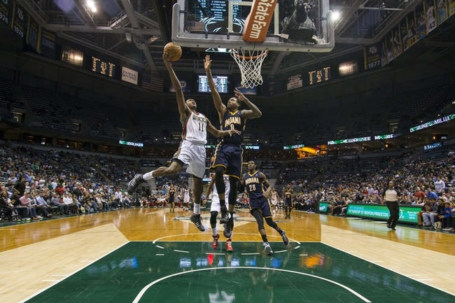 Apr 9, 2014; Milwaukee, WI, USA; Milwaukee Bucks guard Brandon Knight (11) shoots the ball in front of Indiana Pacers guard Rasual Butler (8) during the fourth quarter at BMO Harris Bradley Center.  The Pacers won 104-102.  Mandatory Credit: Jeff Hanisch-USA TODAY Sports