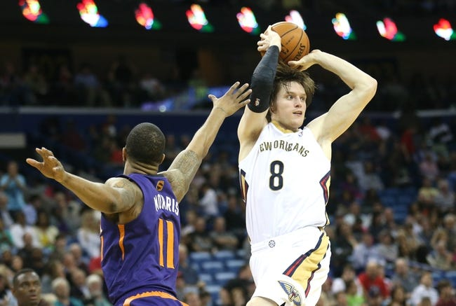 Apr 9, 2014; New Orleans, LA, USA; New Orleans Pelicans forward Luke Babbitt (8) passes the ball in front of Phoenix Suns forward Markieff Morris (11) in the second half at the Smoothie King Center. The Suns won 94-88. Mandatory Credit: Crystal LoGiudice-USA TODAY Sports