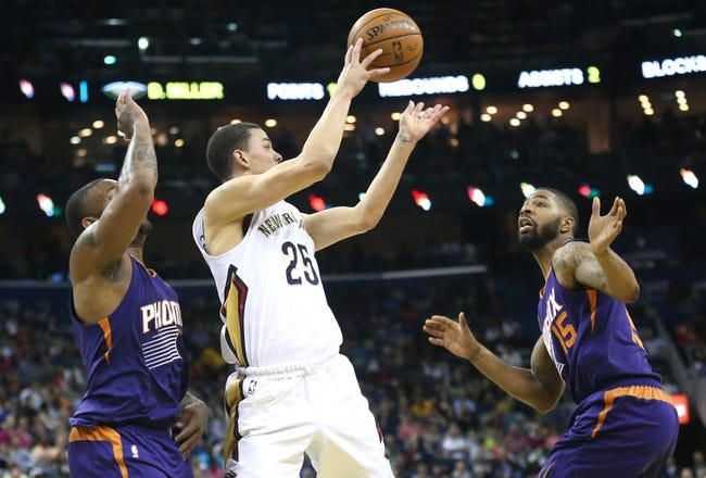 Apr 9, 2014; New Orleans, LA, USA; New Orleans Pelicans guard Austin Rivers (25) passes the ball in front of Phoenix Suns forward P.J. Tucker (L) and forward Marcus Morris (15) in the second half at the Smoothie King Center. The Suns won 94-88. Mandatory Credit: Crystal LoGiudice-USA TODAY Sports