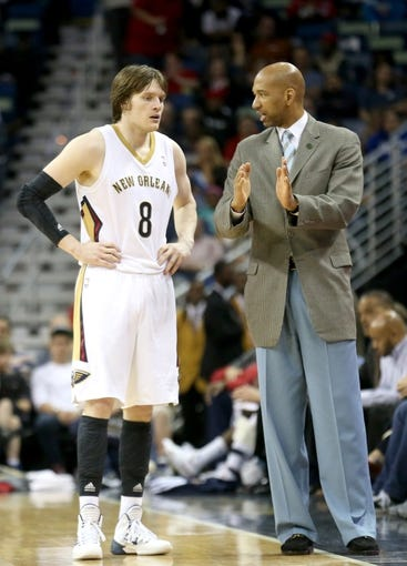 Apr 9, 2014; New Orleans, LA, USA; New Orleans Pelicans head coach Monty Williams (R) talks with forward Luke Babbitt (8) in the second half against the Phoenix Suns at the Smoothie King Center. The Suns won 94-88. Mandatory Credit: Crystal LoGiudice-USA TODAY Sports